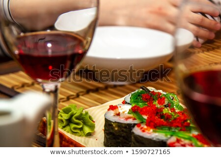woman eating caviar salad at cafe or restaurant Stock photo © dolgachov