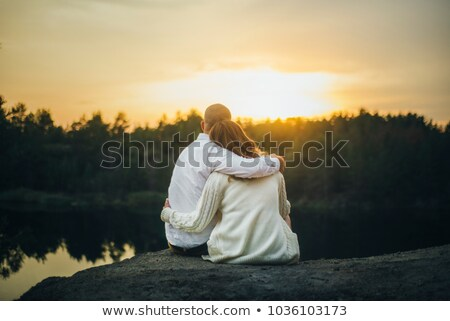 back view portrait of a happy young couple stock photo © deandrobot