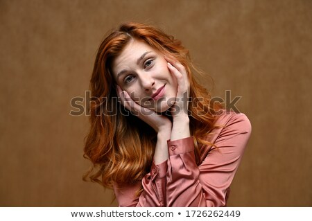 photo of beautiful young woman with long dark hair wearing straw stock photo © deandrobot