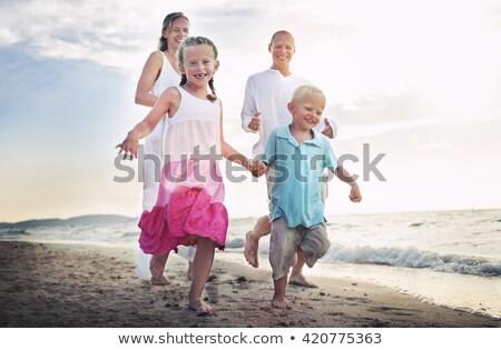 Little Girl Running On The Idyllic Beach Stock photo © AndreyPopov
