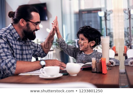 Smiling father and son giving high-five Stock photo © Kzenon