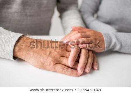 Közelkép fiatal nő tart idős férfi kezek Stock fotó © dolgachov