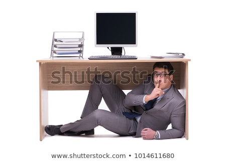 üzletember rejtőzködik férfi asztal asztal állás Stock fotó © Elnur