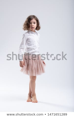 Stock photo: Little girl in pink ballet tutu or filmy skirt