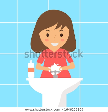Child in kindergarten washing her hands Stock photo © Kzenon