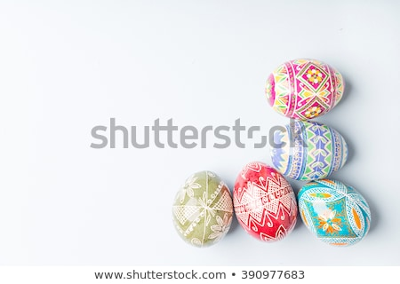 row of colored easter eggs on wooden table Stock photo © dolgachov