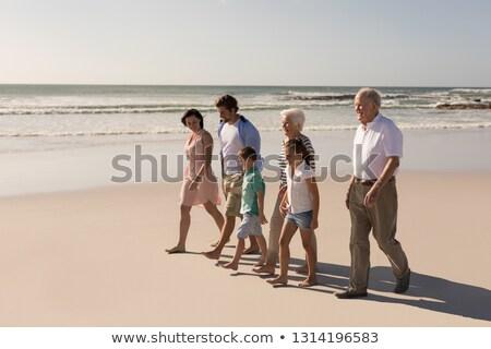 вид сбоку счастливым семьи ходьбе пляж Сток-фото © wavebreak_media