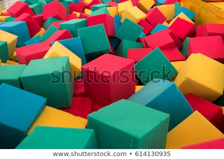 Multicolored foam cubes on the playground in the trampoline center Stock photo © galitskaya