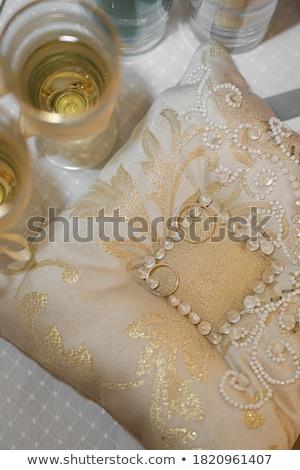Kettő szemüveg pezsgő párna jegygyűrűk esküvő Stock fotó © Illia