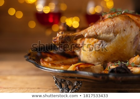 Thanksgiving or Christmas festive dinner on table with lamps hanging above Stock photo © pressmaster