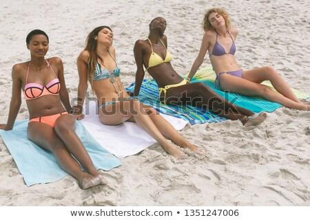 Elöl kilátás többnemzetiségű nők bikini megnyugtató Stock fotó © wavebreak_media