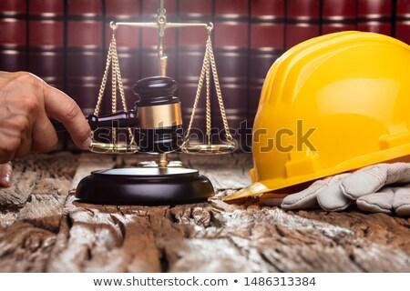 Tokmak sarı kask yargıç ahşap masa inşaat Stok fotoğraf © AndreyPopov