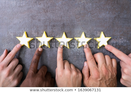 Person Hands Aligning Five Star Rating Icons Stock photo © AndreyPopov