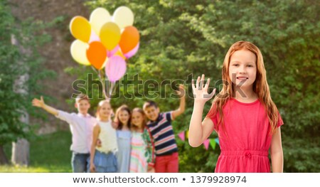 red haired girl waving hand at birthday party Stock photo © dolgachov