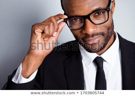 Imagem jovem masculino empregado eriçar mãos Foto stock © vkstudio