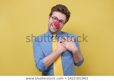 smiling senior woman with red clown nose Stock photo © dolgachov