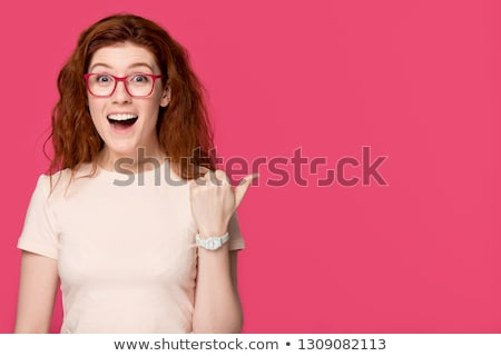 red haired student girl in glasses at optics store Stock photo © dolgachov