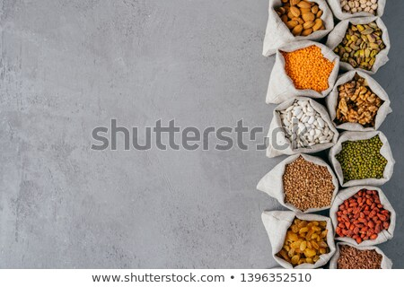Sacks with nutritious healthy products in small sacks standing in row isolated over grey texture bac Stock photo © vkstudio