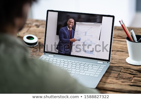 Man Participating In Online Coaching Session Stock photo © AndreyPopov
