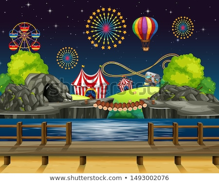 Amusement park scene at night with balloons in the sky Stock photo © bluering