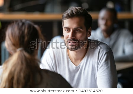 Man talking with girlfriend at cafe table. Friends meeting in city having fun drinking coffee. Coupl Stock photo © Maridav