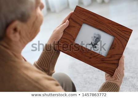 Elderly person looking at photos with son Stock photo © photography33