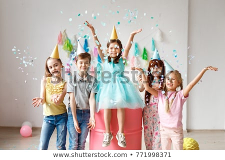 Young girl party time with present and balloons stock photo © darrinhenry