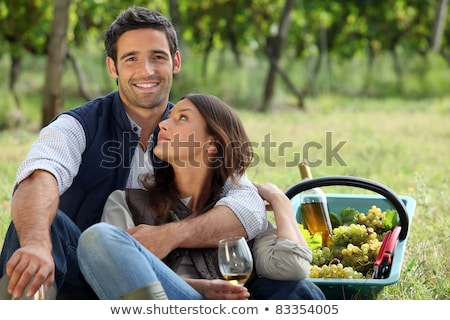 romantic man and woman picking grapes and drinking wine stock photo © photography33