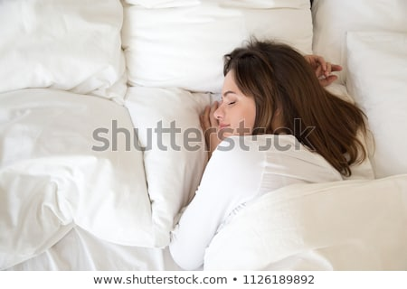 a woman reposing on bed Stock photo © photography33