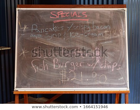 'Fish and chips' handwritten with white chalk on a blackboard stock photo © nenovbrothers