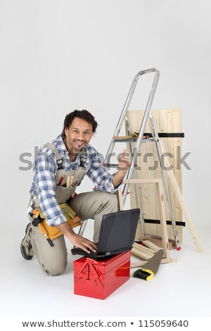 Carpenter contact his customers via the Internet Stock photo © photography33