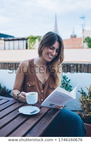 Delighted woman is reading a book outdoor  Stock photo © wavebreak_media