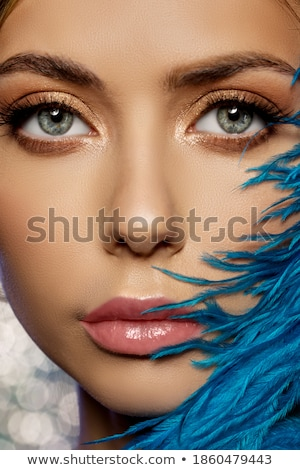 pretty brunette with feathered makeup smiles Stock photo © carlodapino