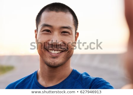 Asia hombre ipad tableta vista lateral Foto stock © Farina6000