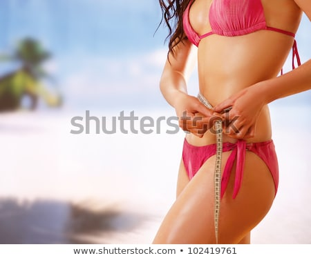Fit woman in bikini measuring waist Stock photo © wavebreak_media