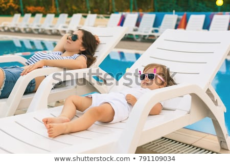 Cute girl tanning near pool Stock photo © Anna_Om