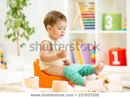 Dość baby posiedzenia kolor nauki WC Zdjęcia stock © Mikko