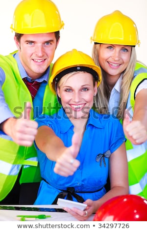 friendly construction workers with thumps up stock photo © kzenon
