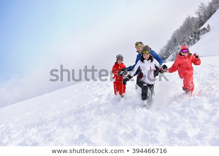 family running in the snow stock photo © kzenon
