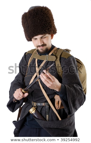 Russian Cossack inspecting a poniard. The living history. stock photo © o_p_m