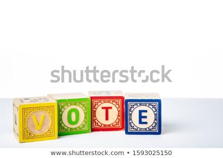 vote on colored wooden childrens alphabet block stock photo © tashatuvango