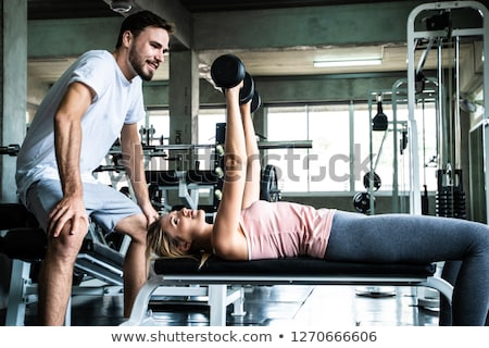 Dumbbell personal trainer man and woman talking Stock photo © lunamarina