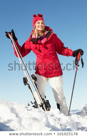 Mid adult woman skiing and smiling Stock photo © bmonteny