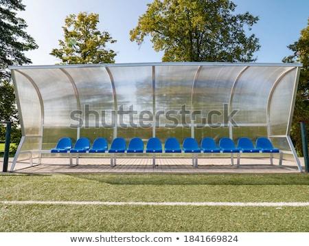 Blauw plastic bank groen gras veld stoel Stockfoto © tarczas