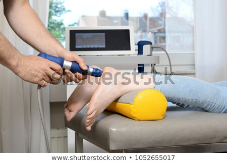 shockwave treatment on the shoulder of a woman stock photo © hofmeester