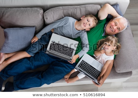 boy on the floor holding tablet in high angle view stock photo © ozgur