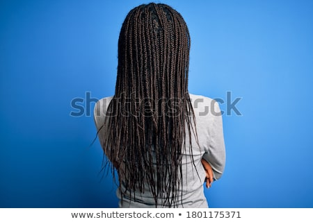 Rear view of a young business woman standing  Stock photo © feedough