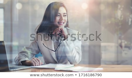 Office Woman Looking Outside Through Glass Window Stock photo © juniart