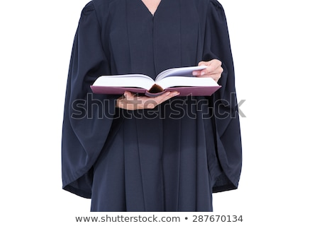 Serious lawyer reading law code  Stock photo © wavebreak_media