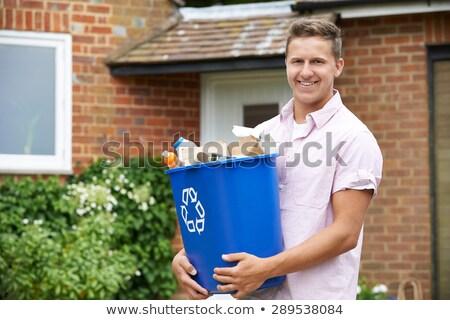 portrait of man carrying recycling bin stock photo © highwaystarz